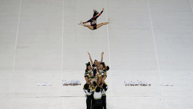 Cheerleaders perform during the opening ceremony of the 17th Asian Games in Incheon