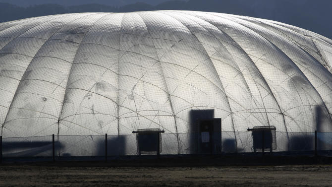 In this Friday, Feb. 22, 2013 photo, a dome-shaped greenhouse is seen in Rikuzentakata, Iwate Prefecture, northeastern Japan. Few businesses have rebuilt in the worst hit areas of the disaster zone, and uncertainty over prospects for reconstruction is deterring most from outside from even considering investments there. One of the few projects to start up here so far, Granpa Farms, is an agrotechnology company from Kanagawa, near Tokyo, that has built eight dome-shaped high-tech greenhouses for hydroponic farming of lettuce and other greens. (AP Photo/Junji Kurokawa)