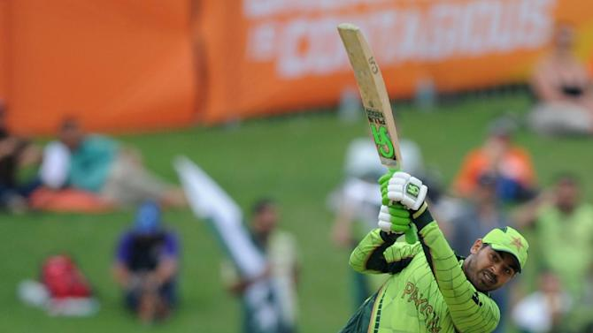 Pakistan's Haris Sohail hits the ball to the boundary as United Arab Emirates wicketkeeper Swapnil Patil  watches during their Cricket World Cup Pool B match in Napier, New Zealand, Wednesday, March 4, 2015. (AP Photo Ross Setford)