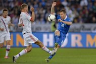 Italy's forward Antonio Cassano (R) kicks a ball next to Russia's midfielder Igor Semshov during a friendly football match against Russia in Zurich. Russia won 3-0