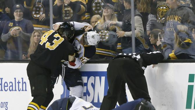 Boston Bruins' Matt Bartkowski (43) fights with Buffalo Sabres' Marcus Foligno (82) after Bartkowski's hit on the Sabres' Brian Gionta (12) in the first period of an NHL hockey game in Boston, Sunday, Dec. 21, 2014. (AP Photo/Michael Dwyer)
