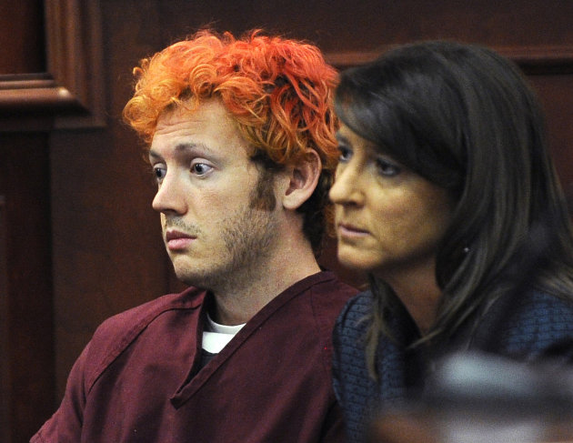 FILE - In this Monday, July 23, 2012 file photo, James Holmes, accused of killing 12 people in Friday's shooting rampage in an Aurora, Colo., movie theater, appears in Arapahoe County District Court w