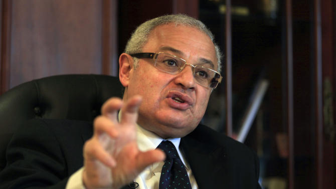 CORRECTS NAME - Egypt's minister of tourism, Hesham Zaazoua, speaks during an interview with the Associated Press at his office in Cairo, Egypt Thursday, March 28, 2013.  Egypt's tourism minister says Iranian tourists would help shore up Egypt's dilapidated tourism industry and would not pose security challenge to the nation. Zaazoua says he does not worry that visiting Iranians would try to export a revolution to Egypt. (AP Photo/Khalil Hamra)