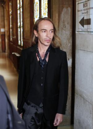 FILE - In this June 22, 2011, file photo, former Dior designer John Galliano arrives at a Paris court house. A Paris court convicted former Christian Dior designer John Galliano on Thursday for making anti-Semitic insults in a bar but gave him only a suspended sentence, taking into account his apology to the victims. Galliano, who didn't attend the announcement of the verdict, was given no prison time. He was given a suspended 6,000 euro ($8,400) fine, which means it goes on his criminal record but he does not have to pay it. (AP Photo/Thibault Camus, File)