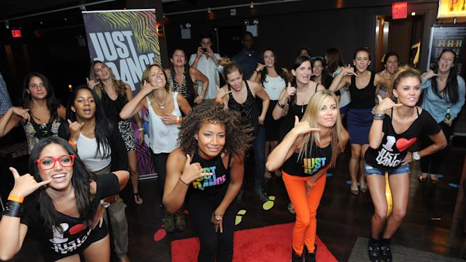 COMMERCIAL IMAGE - Guests at Ubisoft's NYC Dance Party break into a flash mob to 'Call Me Maybe', a highly anticipated track on Just Dance 4 coming out this fall, during the showcase event at New York's Empire Hotel, Wednesday, Aug. 22, 2012. (Photo by Diane Bondareff/Invision for Ubisoft/AP Images)