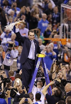 Mike Krzyzewski cuts down the net after his team's 68-63 victory over Wisconsin. (AP)