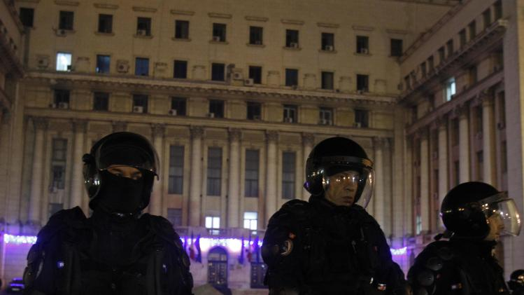 Riot police guard the building from where Romania's late Stalinist dictator Ceausescu had his last speech addressing the people on December 21, 1989, during a protest in Bucharest