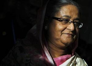 Bangladesh Prime Minister Sheikh Hasina leaves after the closing ceremony of the ASEM Summit in Vientiane