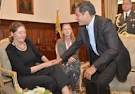Ecuadore President Rafael Correa (right) meets Christine Assange in Quito on Wednesday. The mother of WikiLeaks founder Julian Assange, who is lobbying Ecuador to grant him asylum, says she is worried her son could face execution if extradited to the United States