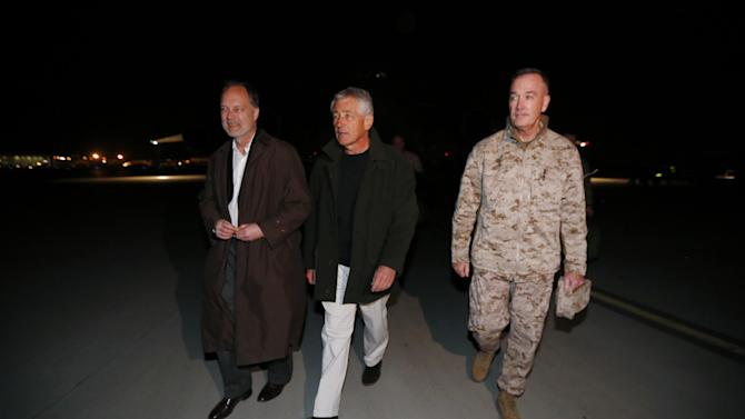 Defense Secretary Chuck Hagel walks with U.S. Ambassador to Afghanistan James Cunningham, left, and Gen. Joseph Dunford, Commander of the International Security Force, upon Hagel's arrival in Kabul, Afghanistan, Friday, March 8, 2013. Hagel arrived in Afghanistan Friday for his first visit as Pentagon chief, saying that there are plenty of challenges ahead as NATO hands over the country's security to the Afghans.  (AP Photo/Jason Reed, Pool)