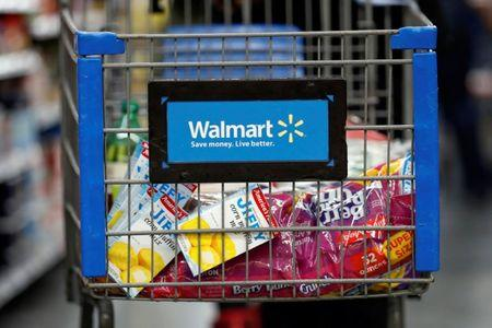 A customer pushes a shopping cart at a Walmart store in Chicago