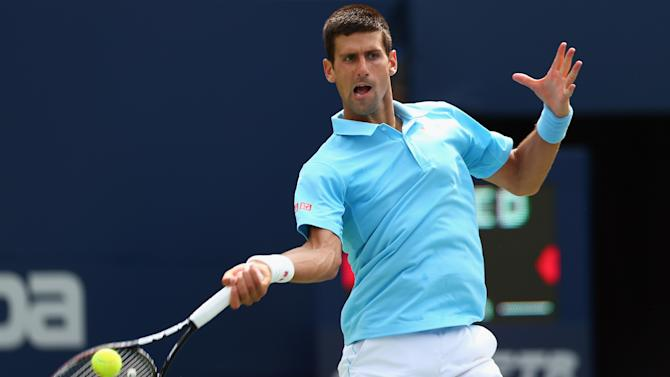 Novak Djokovic returns a shot to Gael Monfils during the Rogers Cup in Toronto, August 6, 2014