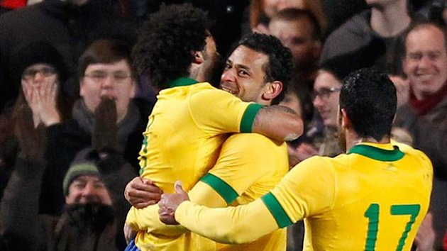 Brazil striker Fred celebrates scoring the equalising goal during the international friendly football match against Russia at Stamford Bridge (AFP)