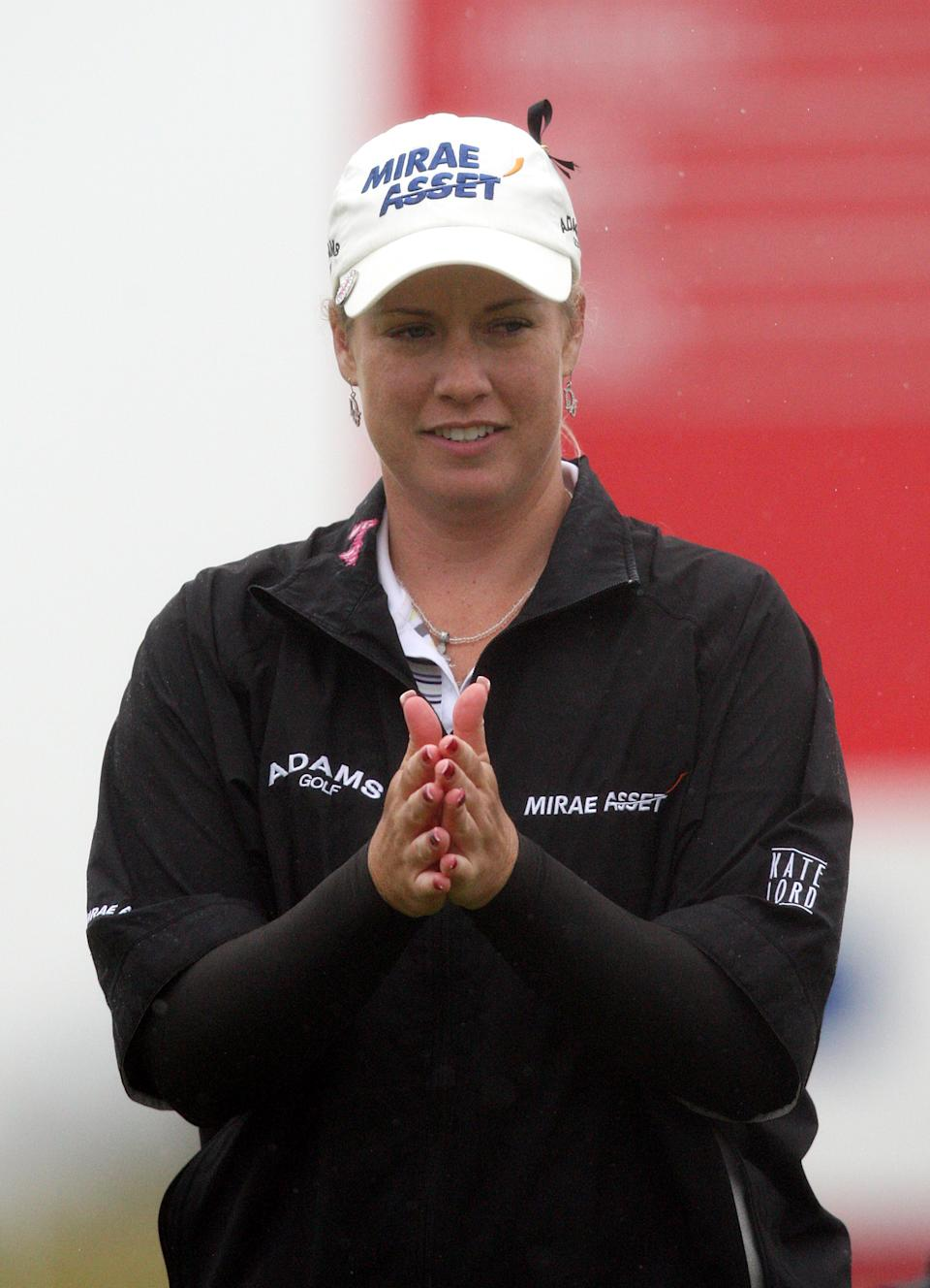 Brittany Liniciome of the US, reacts after finishing the first round of the Women's British Open at Carnoustie Golf Club, Carnoustie, Scotland, Thursday July 28, 2011.(AP Photo/Scott Heppell)