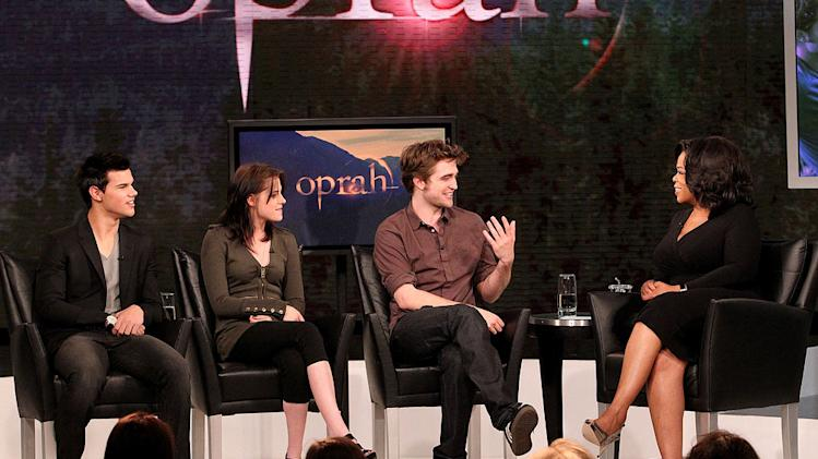 "The cast of ""Twilight"" — Taylor Lautner, Kristen Stewart, and Robert Pattinson — with Oprah on ""The Oprah Winfrey Show."""