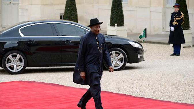 Goodluck Jonathan arrives at the Elysee Palace in Paris on December 6, 2013 for a summit on peace and safety in Africa