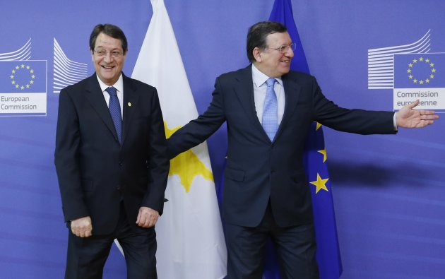 Cyprus' President Anastasiades is welcomed by European Commission President Barroso ahead of a meeting in Brussels