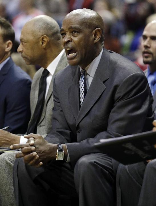 Milwaukee Bucks head coach Larry Drew yells to his players during the second half of an NBA basketball game against the Washington Wizards, Wednesday, Nov. 27, 2013, in Milwaukee. The Wizards won 100-