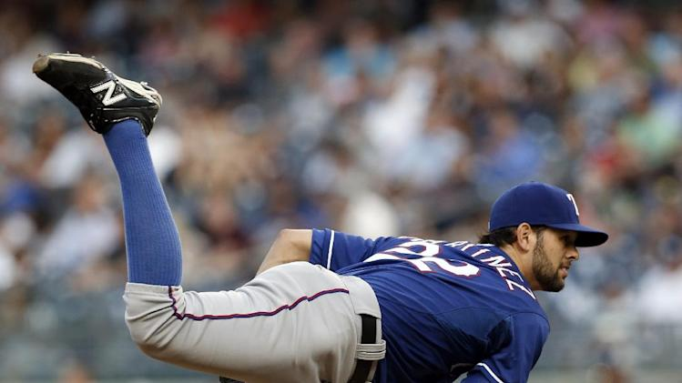 Texas Rangers starting pitcher Nick Martinez delivers in the first inning of a baseball game against the New York Yankees at Yankee Stadium in New York, Tuesday, July 22, 2014. (AP Photo)