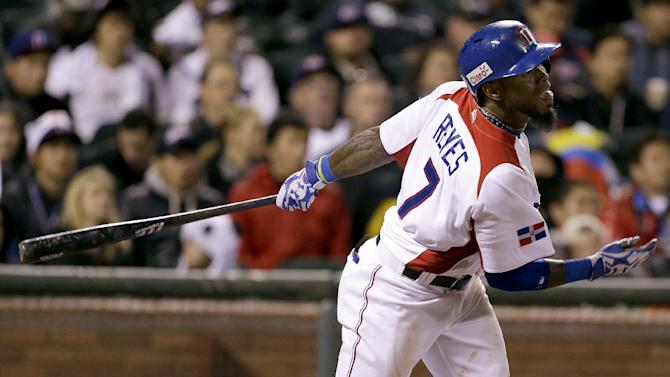 Dominican Republic's Jose Reyes (7) singles to score Moises Sierra during the fifth inning of a semifinal game of the World Baseball Classic against the Netherlands in San Francisco, Monday, March 18, 2013. (AP Photo/Eric Risberg)