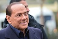 <p>Italian former prime minister and owner of the AC Milan football team, Silvio Berlusconi, arrives at the AC Milan training grounds in Milanello. Berlusconi has ended weeks of speculation by announcing he will again run for the job of prime minister, which he was forced out of last year.</p>