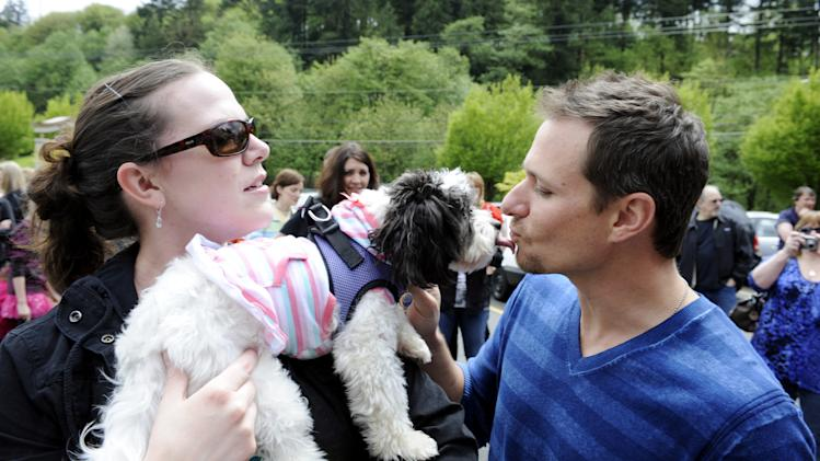 "In this photograph taken by AP Images for Banfield® Pet Hospital, Drew Lachey (98 Degrees), multi-platinum recording artist and Dancing with the Stars winner greets Maggie and her owner Joyell Hardy after the dog won first place in Banfield's ""Dance Your Tail Off"" competition to celebrate the opening of the new Banfield Pet Hospital, Saturday, May 5, 2012, in Portland, Oregon. As the world's largest veterinary practice, Banfield Pet Hospital offers comprehensive medical services including surgery, preventive care, routine examinations and nutrition counseling. (Greg Wahl-Stephens/AP Images for Banfield Pet Hospital)"