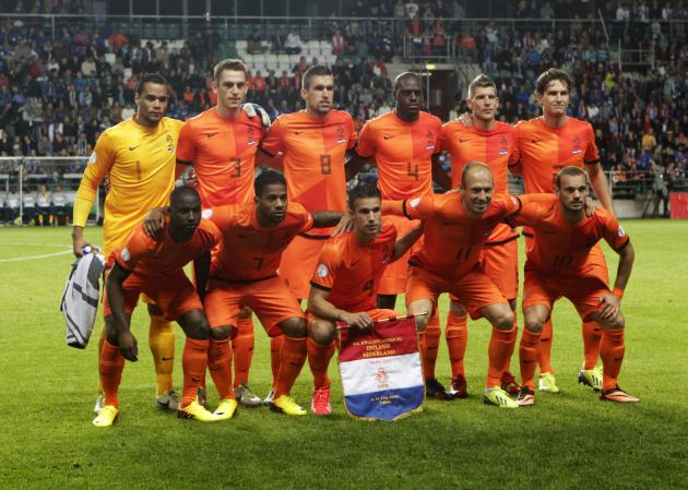 The Netherlands team poses before their 2014 World Cup qualifying soccer match against Estonia in Tallinn