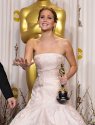 Jennifer Lawrence poses with her award for best actress in a leading role for &quot;Silver Linings Playbook&quot; during the Oscars at the Dolby Theatre on Sunday Feb. 24, 2013, in Los Angeles. (Photo by John Shearer/Invision/AP)