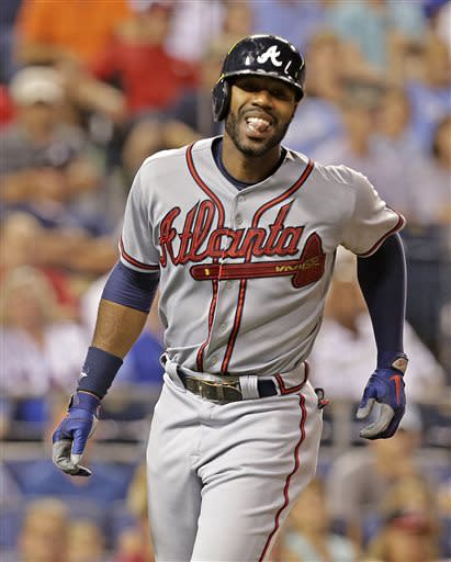Atlanta Braves' Jason Heyward reacts after being hit by a pitch thrown by Kansas City Royals pitcher Will Smith during the ninth inning of a baseball game Tuesday, June 25, 2013, in Kansas City, Mo