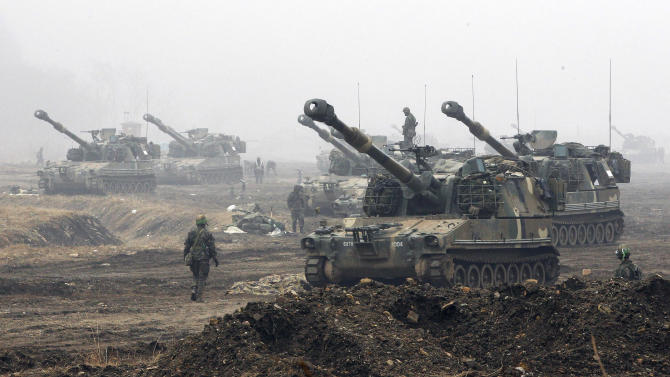 In this April 3, 2013, photo, South Korean Marine K-55 self-propelled howitzers are on positions during an exercise against possible attacks by North Korea near the border village of Panmunjom in Paju, South Korea. North Korea's latest outburst of nuclear and military threats has given the U.S. a rare opportunity to build bridges with China _ a potential silver lining to the simmering crisis that could revitalize President Barack Obama's administration's flagging policy pivot to Asia. (AP Photo/Ahn Young-joon)