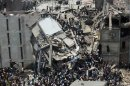 File photo of people rescuing garment workers trapped under rubble at the Rana Plaza building after it collapsed, in Savar