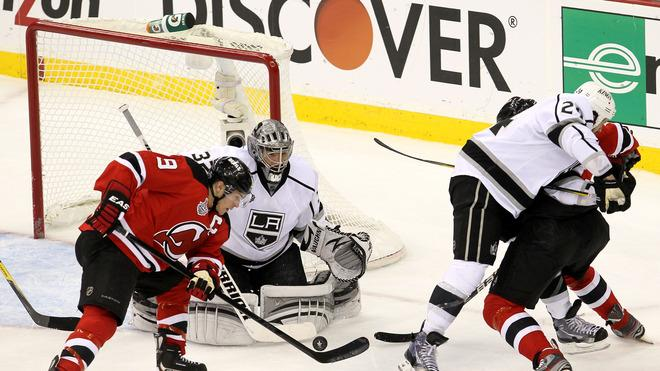 Zach Parise #9 Of The New Jersey Devils Goes For A Loose Puck In Front Of Jonathan Quick #32 Of The Los Angeles Kings  Getty Images