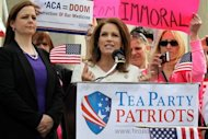 "Former White House hopeful Michele Bachmann, pictured (2nd L) during a rally in front of the US Supreme Court in March, said Thursday she has decided to drop her dual Swiss nationality and just hold a US passport, because ""I am a proud American citizen."""