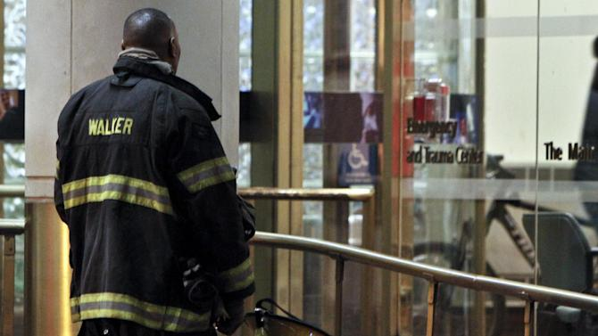 A fireman waits outside the emergency room at Thomas Jefferson Hospital in Philadelphia, Saturday, April 6, 2013, after Capt. Michael Goodwin was brought to the hospital. A fire caused a partial roof collapse that killed Goodwin and injured a colleague who was trying to rescue him, officials said. (AP Photo/ Joseph Kaczmarek)
