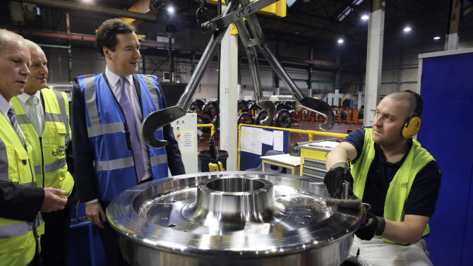 Britain's Chancellor of the Exchequer George Osborne, center, talks to workers during a tour of the train wheel manufacturers Lucchini UK, at Trafford Park, Manchester, England, Monday Jan. 28, 2013. The British government on Monday unveiled details of new high-speed rail lines linking London to cities in northern England with trains traveling up to 225 miles an hour (360 kph). The government says the project, known as High Speed 2, will be the first new railway built north of London for more than a century, and will be an economic and environmental boon. But opponents claim the plan is too expensive and will ruin tracts of picturesque countryside. (AP Photo/PA, Christopher Furlong) UNITED KINGDOM OUT  NO SALES  NO ARCHIVE