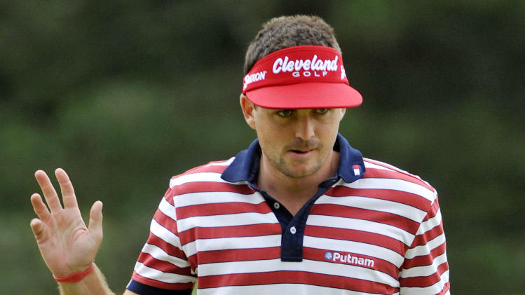Keegan Bradley reacts after making a birdie putt on the seventh hole during the final round of the Bridgestone Invitational golf tournament at Firestone Country Club in Akron, Ohio, Sunday, Aug. 5, 2012. (AP Photo/Phil Long)