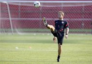 U.S. head coach Juergen Klinsmann kicks the ball during a practice session in San Pedro Sula February 5, 2013. REUTERS/Stringer/Files
