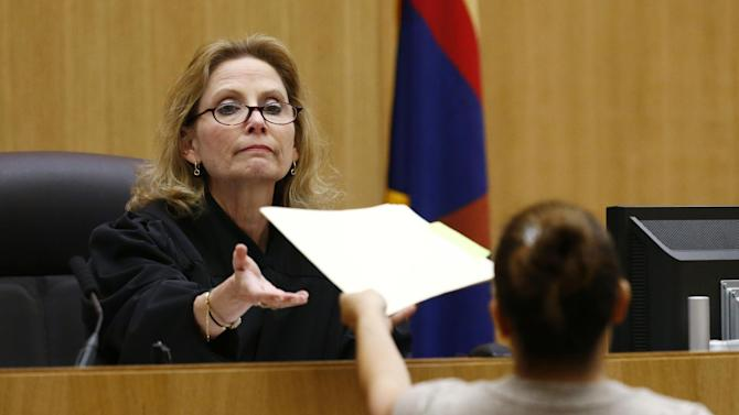 Judge Sherry Stephens is handed the decision which found Jodi Arias guilty of first-degree murder in the gruesome killing of her one-time boyfriend, Travis Alexander, in their suburban Phoenix home, Wednesday, May 8, 2013, at Maricopa County Superior Court in Phoenix.  (AP Photo/The Arizona Republic, Rob Schumacher, Pool)