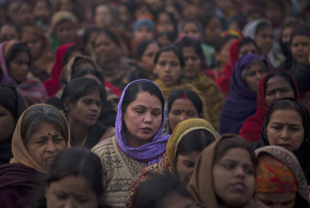 Indian women offer prayers for a gang rape victim at Mahatma Gandhi memorial in New Delhi, India, Wednesday, Jan. 2, 2013. India's top court says it will decide whether to suspend lawmakers facing sex