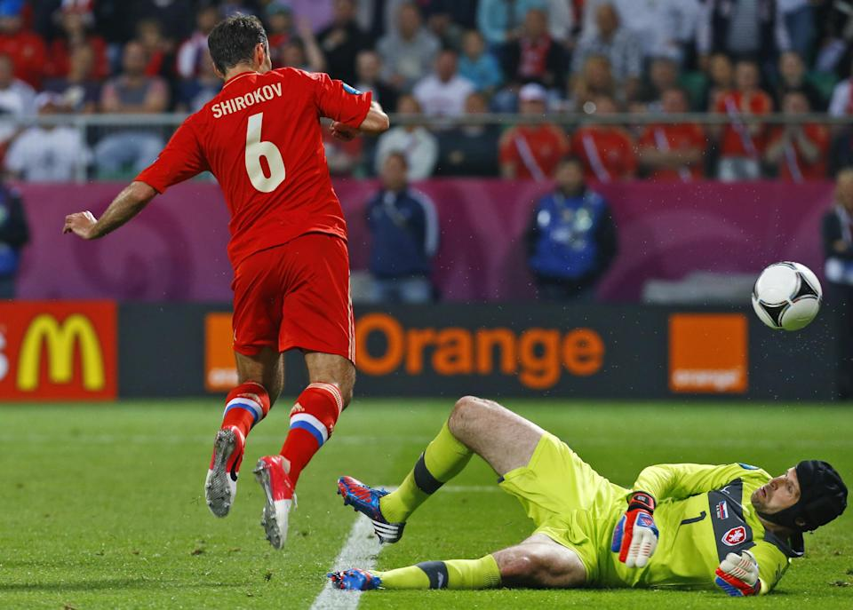 Russia's Roman Shirokov scores over Czech goalkeeper Petr Cech during the Euro 2012, Group A soccer match between Russia and Czech Republic, in Wroclaw, Poland, Friday, June 8, 2012.  (AP Photo/Sergey Ponomarev)