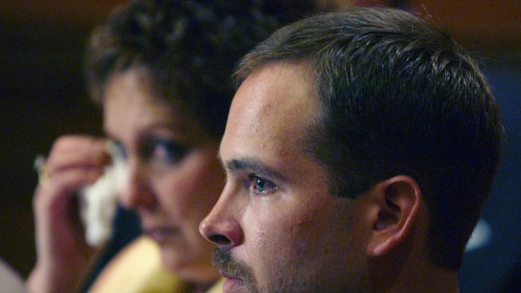 FILE - In this June 16, 2004 file photo, Arthur Baselice III attends a news conference accompanied by his mother, Elaine Baselice, background, in Philadelphia. Baselice III died of an overdose in 2006, after his 2004 civil suit accusing a Philadelphia priest of abuse was thrown out. (AP Photo/Jacqueline Larma, File)