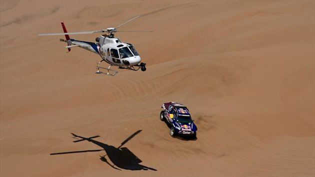 Qatar's Nasser Al-Attiyah steers his buggy during the Stage 6 of the 2013 Dakar Rally between Arica and Calama, Chile (AFP)