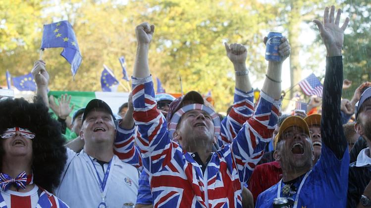 European fans are sprayed with Champagne as they celebrate winning the Ryder Cup PGA golf tournament Sunday, Sept. 30, 2012, at the Medinah Country Club in Medinah, Ill. (AP Photo/Charles Rex Arbogast)