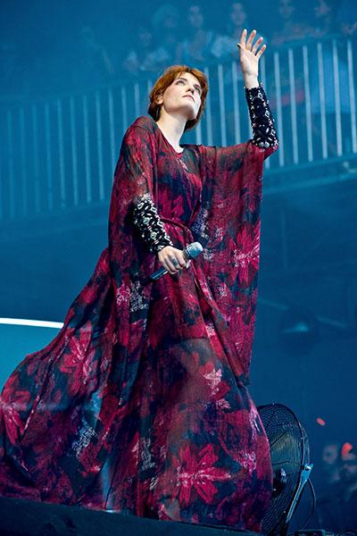 Florence took to the stage at Lollapalooza in a Toujouri black and fuchsia printed floral kimono with oversized tight jeweled cuffs.  (Photo by Timothy Hiatt/WireImage)