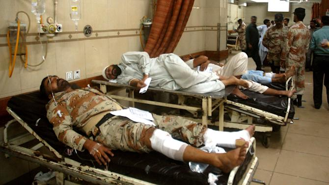 People injured in an explosion lie at a local hospital in Karachi, Pakistan on Thursday, Nov. 8, 2012. A suicide bomber smashed a truck packed with explosives into housing for a paramilitary force protecting Pakistan's largest city, killing at least one person in the explosion Thursday morning that sent a large plume of smoke into the sky, officials said. (AP Photo/Shakil Adil)