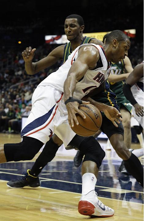 Atlanta Hawks center Al Horford, foreground, drives against Utah Jazz small forward Jeremy Evans in the second half of an NBA basketball game on Friday, Dec. 20, 2013, in Atlanta