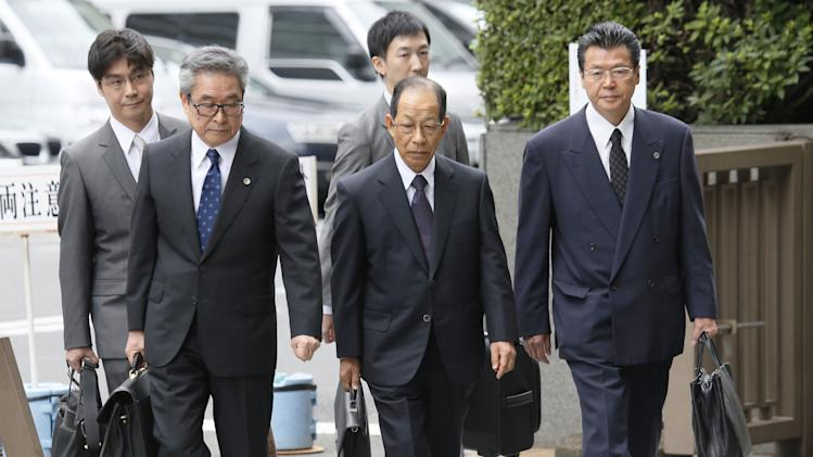Ex-president of Japan's Olympus pleads guilty