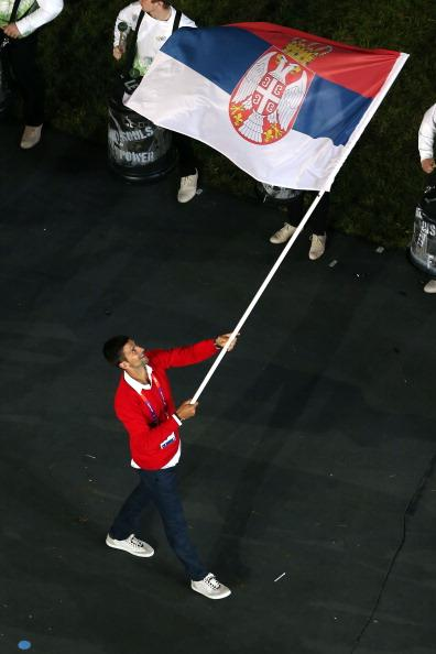 Carrying the Serbian flag during the Olympics' opening ceremonies