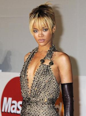 "FILE - In this Feb. 21, 2012 file photo, performer Rihanna arrives for the Brit Awards 2012 at the O2 Arena in London. Rihanna says her collaboration with former boyfriend Chris Brown made sense. Brown appears on a remix to her song ""Birthday Cake"" and she appears on a remix to his ""Turn Up The Music."" Their music union is noteworthy because Brown beat Rihanna up three years ago and is still on probation for the assault. She says the partnership allowed their fans to come together and says ""there shouldn't be a divide. ... It's music, and it's innocent."" She made the comments to Ryan Seacrest on his radio show on KIIS-FM in Los Angeles. (AP Photo/Jonathan Short, file)"