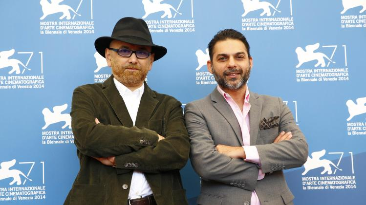 """Actors Habib Rezaei and Peyman Moaadi pose during the photo call for the movie """"Ghesseha"""" (Tales) at the 71st Venice Film Festival"""